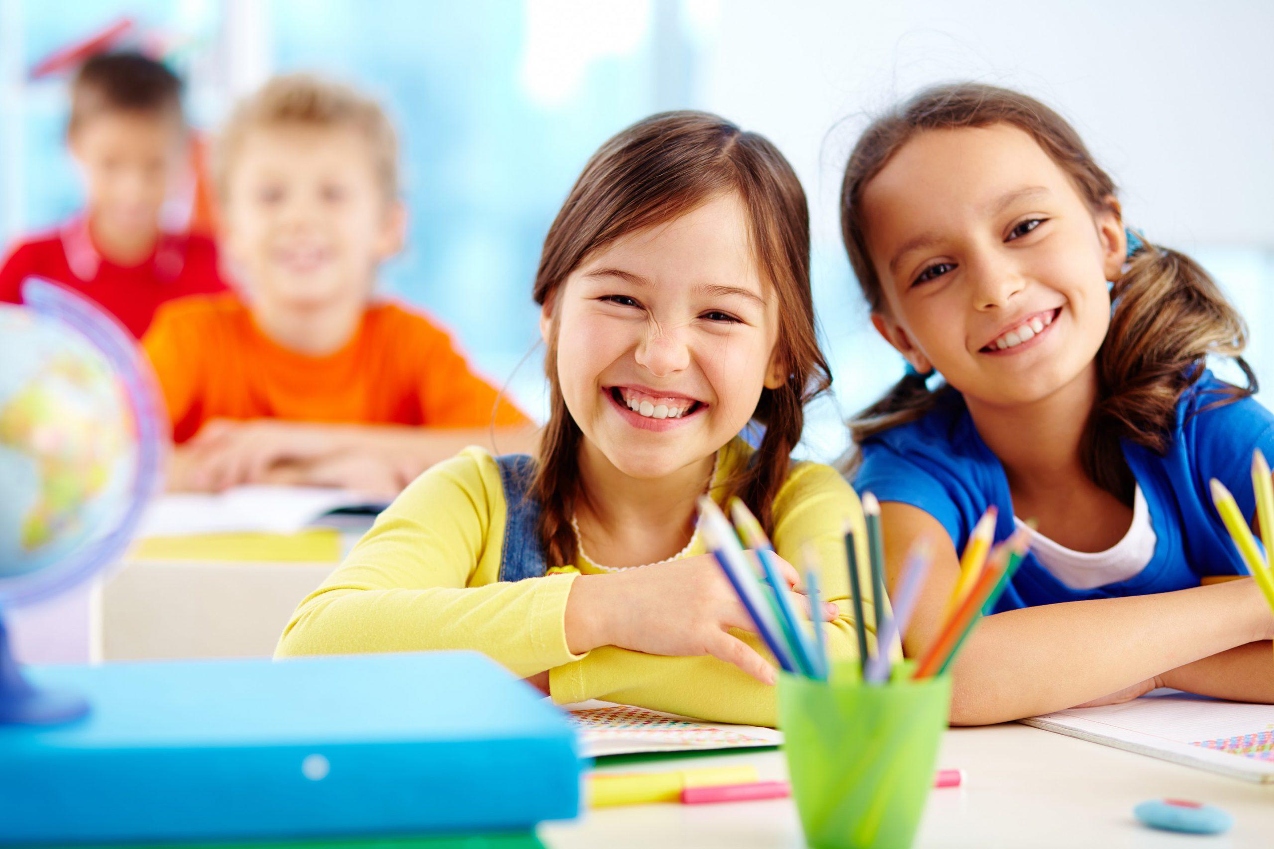 children smiling at school